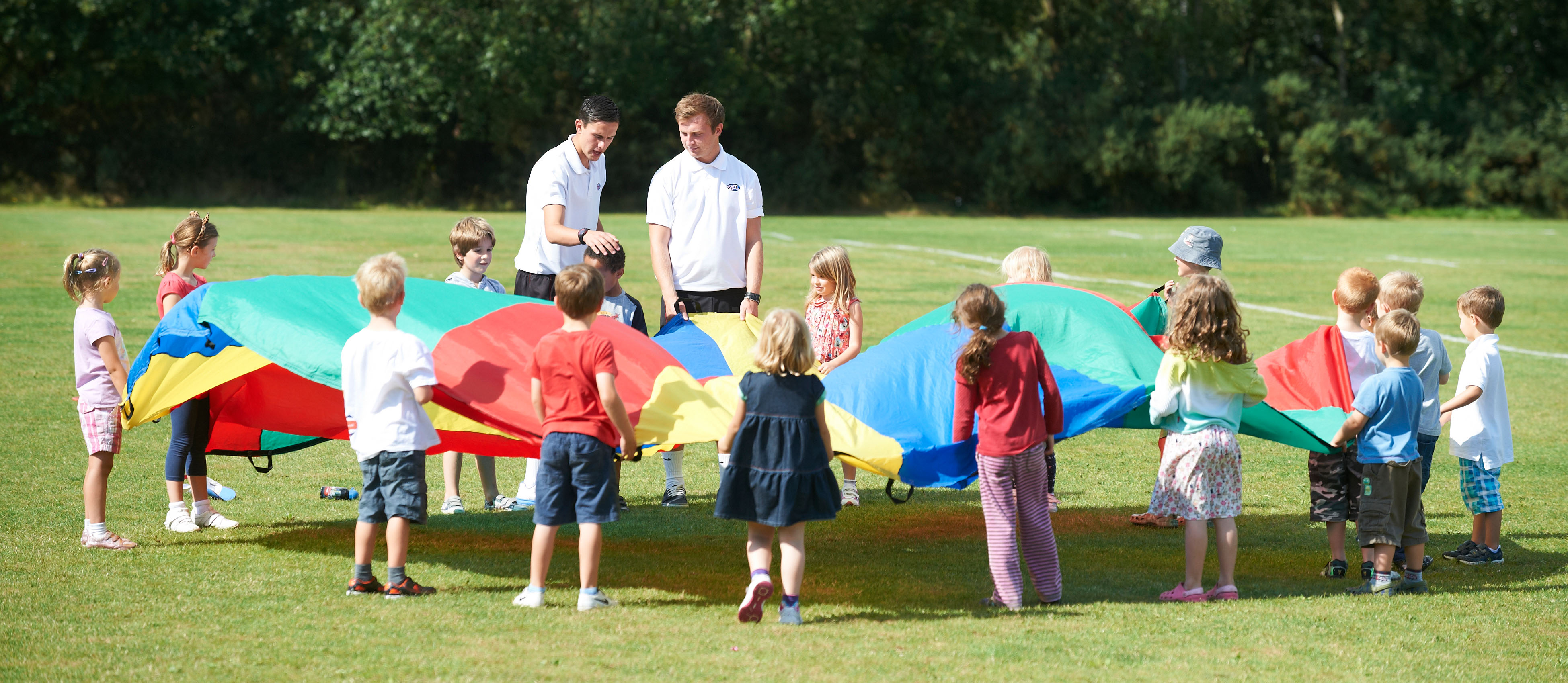 Coaches providing sports activities for a primary school during the summer holidays.