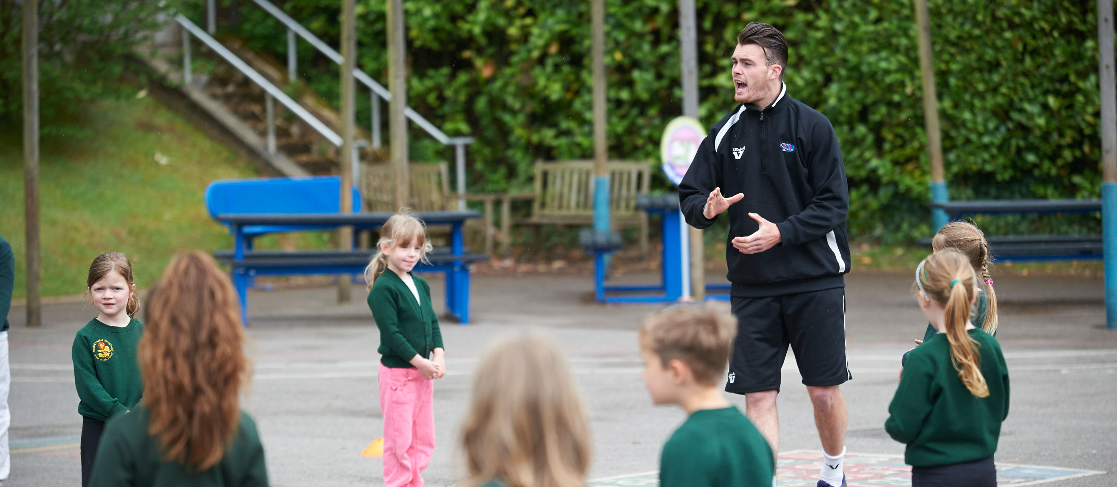 SCL coaches providing a sports session with primary school children to cover for PPA