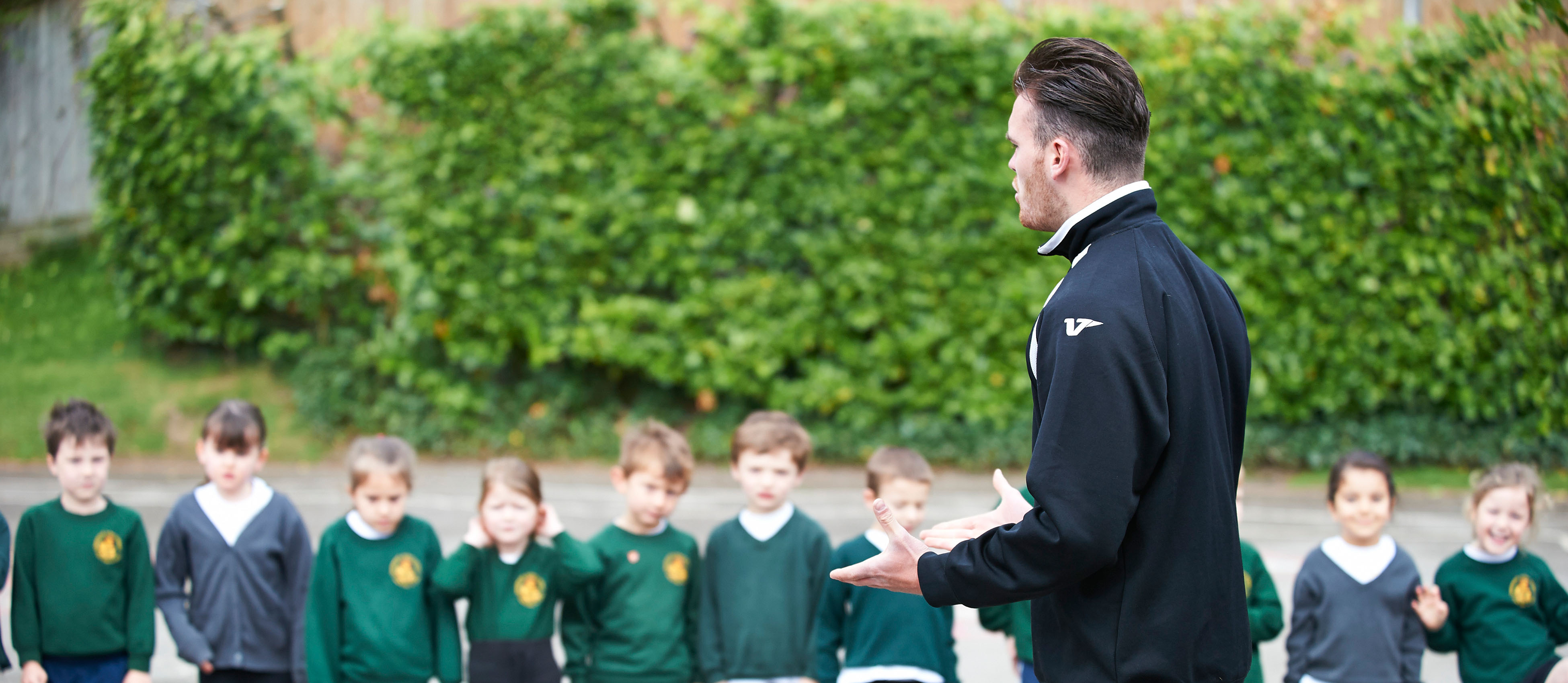 An SCL coach providing a practical teacher training session at a primary school